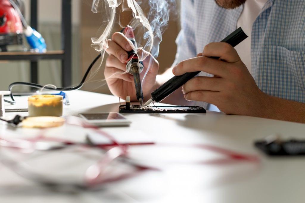 Employee Executing Hand soldering process